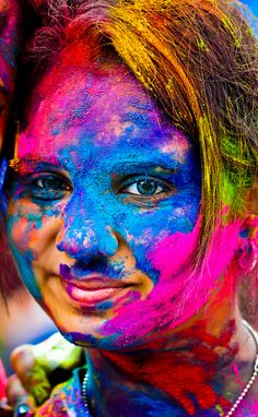 Hypnotizing Blue Eyes by S YY at a Holi Festival