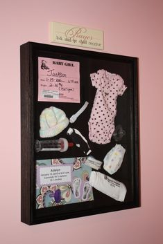 Shadow box with babys stuff from the hospital.way better than sitting in a box somewhere wish I would have thought of this with Kailyne Ann Bradley :) I love my baby girl. (: can't wait to have another sweet baby.