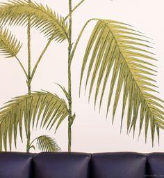 Baz Bagel shop in the Lower East Side, blue couch, mural prints / Garance Doré