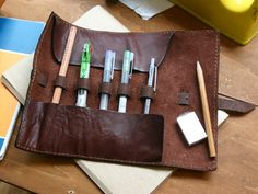 Pen or tool holder -- Good idea... nice for calligraphy pens maybe or keeper for special tools