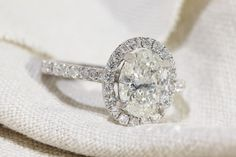 1.20 ct Oval Halo Engagement Ring AT A WHOLESALE PRICE - Diamond and Gold Warehouse - best engagement rings dallas - halo engagement rings, oval engagement ring, popular engagement ring, trending engagement ring