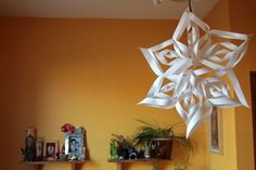 snowflake- turned out to be 2.5-3 ft wide.  did it with large square sparkly white paper and a glue gun.  glue gun was awesome - took about 20-30 minutes