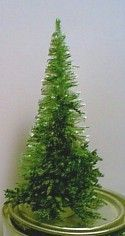 Miniature Evergreen Tree tutorial for using a bottle brush tree as a base and in-filling it with Caspia ( dried plant material) to fill out and shape