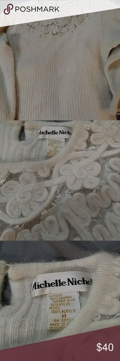 80% Angora Rabbit Fur 20%Nylon Off White Sweater Loved 80%Angora Rabbit fur and 20% Nylon long sleevwd off white sweater with beautiful lace and off white flowers around the neckline and a butyon at the neck in the back. Will get dry cleaned before shipped! Michelle Nicole Sweaters Crew & Scoop Necks