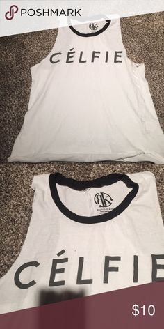 Celfie muscle tank Good condition just a dot of stain above the L. Havnt tried removing it only washed it so I'm sure it will come out if tried. Celine Tops Muscle Tees