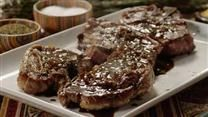Tender, fall-off-the-bone rosemary-kissed lamb shoulder chops and a rich, succulent gravy with red wine are what you get for making this recipe.