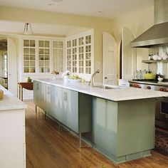Defined Kitchen Work Zones - This is such a great idea! Also, having the cabinetry up off the floor so your toes don't kick is a great way to add functionality and also give visual space.