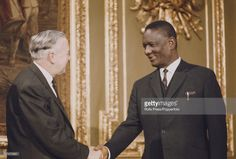 Prime Minister of the United Kingdom Harold Wilson on left, shakes hands with Prime Minister of Sierra Leone, Siaka Stevens at the 1969 Commonwealth Prime Ministers' Conference at Marlborough House in London on January Harold Wilson, Marlborough House, Shake Hands, Prime Minister, Commonwealth, Sierra Leone, Conference, United Kingdom, January
