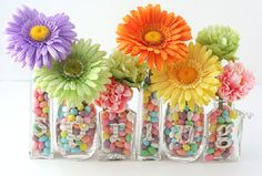 Fun centerpiece idea. Instead of letters insert table numbers for wedding guests! :)