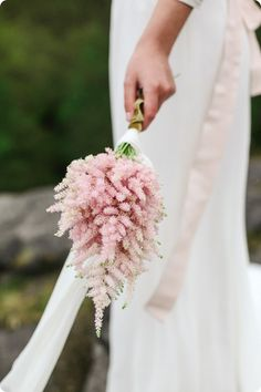Simple bouquet of pink astilbe