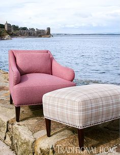 "Baker's ""Avenue"" chair and ottoman mix Johnstons of Elgin's ""Nairn Russet"" solid with ""Attadale Biscuit"" tartan. - Traditional Home ® / Photo: Dominic Blackmore"