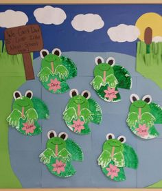 Summer themed preschool bulletin board.  Painted paper plates and flowers to look like lily pad, handprint frogs, and a background to look like a pond