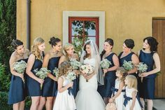 Navy and Peach DIY Wedding From Anita Martin Photography  I love the baby's breath bridesmaid bouquets!