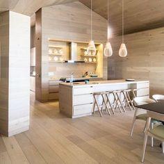 Floor to ceiling Oak wood finished with WOCA Diamond Oil for wood floors.  Neutral, luxury kitchen.  Wilderness, South Africa featuring a Oggie Fsc European Oak wide-plank floor with Woca Denmark Diamond Oil.