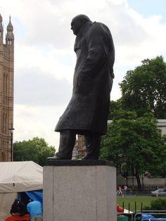 Winston Churchill in Parliament Square facing his favorite pub. #London