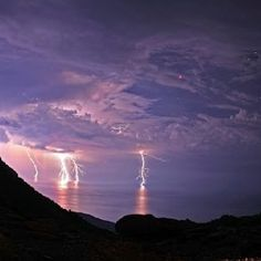 Lunar Eclipse & Lightening - Icaria, Greece - photo by Chris Kotsiopoulos