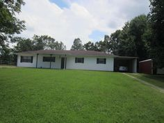 This three bedroom, two bath home sits on l.47 acres just a few minutes from Batesville,AR. Kitchen, Dining, and living room combination with three bedroom, two baths, family room, and laundry room. Nice screened in back porch for your evening enjoyment. New Bald Eagle barn. Extra lot is beautiful and would be a great building spot. Equal Housing Opportunity.