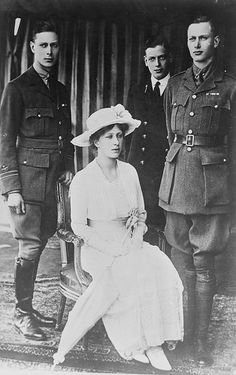 Four of the six children of King George V and Queen Mary: TRH Princes Albert, George, and Henry (standing) and Princess Mary.  Edward (the eldest son) was not present, and Prince John (the youngest) had predeceased his parents.