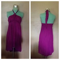 NWT FP Beach Halter Dress Coverup Super cute halter dress from Free People! Color is fuchsia/magenta. Features: cute details on the top, elastic/stretch in the back, and a high low hem. Never worn, brand new with tags. Free People Dresses