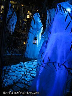 Ghosts in the garden... chicken wire frames with old curtains make these ghosts glow in blue light.