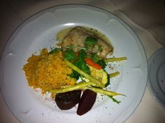 Pickerel fish with couscous and garden vegetables.