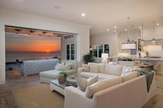 The open floor plan of this southern California home allows for breathtaking views of the ocean from practically anywhere. The comfortable living room leads out to an outdoor loggia with graphic-patterned sectional.