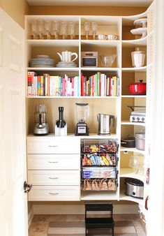 Walk-in pantry with area for large appliances! space below the shelves! love this