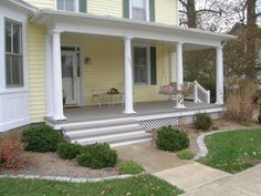 Front Porch: Painted Clapboard Siding and Raw Concrete Deck.
