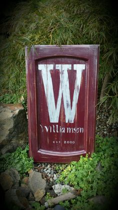 Monogram sign on recycled cabinet door