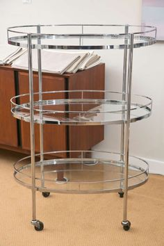 Mid-Century Tri-Level Chrome Barcart | From a unique collection of antique and modern bar carts at http://www.1stdibs.com/furniture/tables/bar-carts/