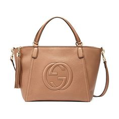 """Soho small crossbody tote by Gucci. Gucci leather tote with embossed interlocking """"G"""" detail. Light golden hardware. Top handles with..."""