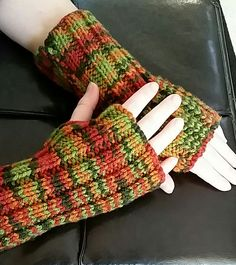 Free Knitting Pattern for Easy Cozy Wristers - Easy fingerless mitts are knit flat on straight needles. Designed by Cathy Payson for Red Heart. Great for self-striping or multi-color yarn. Rated easy by designer and Ravelrers. Pictured project by luvbnamom6