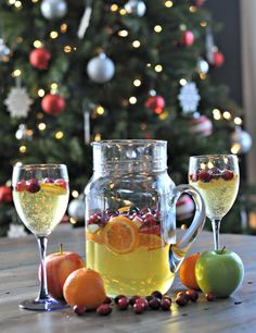 Holiday sangria made with white wine and sparkling cider. Bubbly and beautiful. @decorandthedog