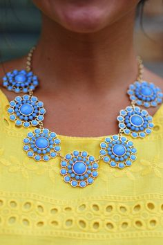 light blue statement necklace + yellow top