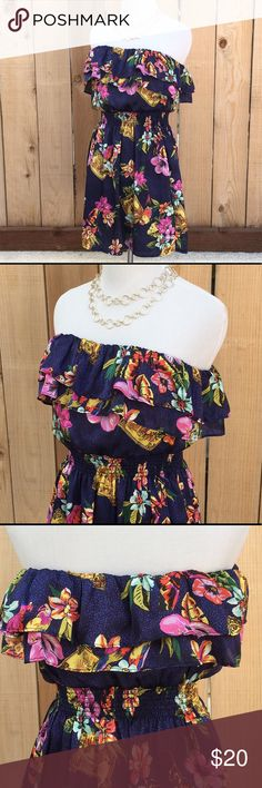 "🆕 Floral Strapless Sundress Strapless sundress has a variety of colors creating a floral print on a navy blue background. Top held up with 1/4"" elastic. Measurements are 13"" pit to pit relaxed & 18"" stretched. Length is 27.25"". Waist has a 1.75"" rouched elastic and is 11"" side to side. Stretched is 17"". All measurements are on side laid flat in counter. In excellent like new condition. Worn once. Forever 21 Dresses Strapless"