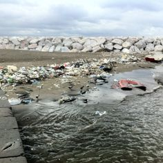 The before picture of a beach clean up at the America's Cup World Series in Naples Italy.
