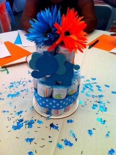 Diaper cake centerpiece for a baby boy (Baby Shower).  It was fun making them.