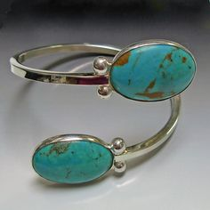 SOLD - Handcrafted sterling silver bracelet with two turquoise cabochons (25mm x 10mm) on either end.  Aaron Rubinstein.