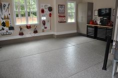 Creekbed #epoxyflooring with Driftwood #garagecabinets | Installed by Carolina Custom Garages