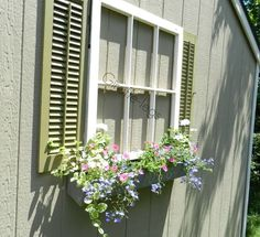 Repurposed Window Planters - These rescued window panes have been repainted and restored as feature planters & hung on the side of a garage to dress it up above a herb garden. Description from pinterest.com. I searched for this on bing.com/images