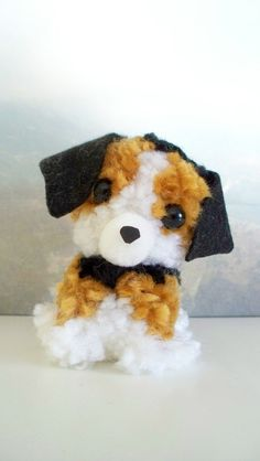 Penelope is looking for a good home. Each puppy begins its life as 16 yards of yarn and a spark of imagination. Assembled from hand-crafted