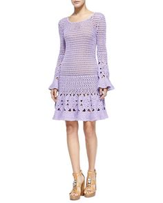 Michael Kors dress with hand-crocheted floral design. Scoop neckline; long trumpet sleeves. Bias-cut silhouette. Cashmere/cotton. Imported.