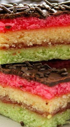 Almond scented Italian rainbow cookies, layered with raspberry and apricot jams, topped with melted chocolate and sprinkled with chocolate jimmies. Italian Christmas Cookie Recipes, Italian Desserts, Italian Pastries, Italian Rainbow Cookies, Italian Cookies, Cookie Desserts, Dessert Recipes, Yummy Cookies, Bar Cookies