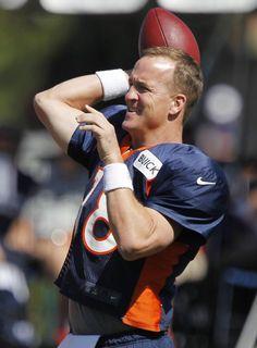 Denver Broncos practice | Denver Broncos quarterback Peyton Manning warms up during NFL football practice