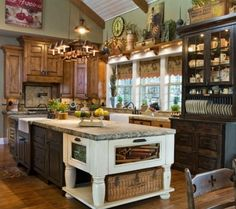 Somehow the mismatched cabinetry works. country primitive decor- there's a lot going on, but there are parts that I like