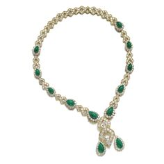 Emerald and diamond necklace, Van Cleef & Arpels Designed as a series of kite-shaped motifs set with brilliant-cut diamonds, alternating with pear-shaped links set with cabochon emeralds and brilliant-cut diamonds, separates into six pieces, which can be worn as bracelets and a brooch, necklace length approximately 520mm, bracelet lengths approximately 175mm, each piece signed VCA, numbered, French assay and maker's marks.