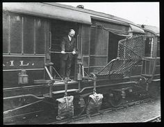 Travelling Post Offices were rail services on which mail was collected, sorted and dispatched on the move. This lantern slides shows mail bags in position on the train, with the net down. Post Boxes Uk, General Post Office, Mail Delivery, Going Postal, British Rail, Royal Mail, Offices, Lantern, Travelling