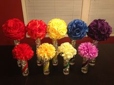 Tall and short rainbow centerpieces with kisses inside