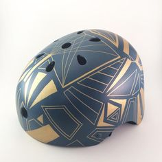 A dazzling dark blue and gold art deco bicycle helmet that will protect you, while you look chic and awesome. This helmet is hand-painted with acrylics in our s