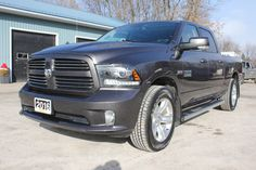"2016 RAM Sport 1500 4x4 Crew Cab – ONLY 15,400 KMS Navigation, Sunroof, RearView Camera, Leather Seats, Heated & Cooled Front Seats, Heated Steering Wheel, Bluetooth, Trailer Tow, Power Sliding Rear Window, Step Bars, Box Liner,  20"" Wheels, 5.7L V8 Hemi, Uconnect® 8.4-inch Touch/SiriusXM/Hands-free/NAV, Hands-free communication with Bluetooth® streaming, Media hub w/ SD card slot, USB and Aux Input Jack, Balance of Factory Warranty and only 15,400 KM  42,880 +tax or 324 Bi-Weekly oac"